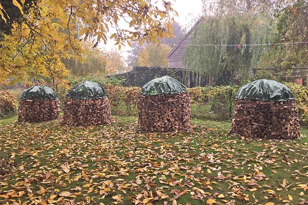 Holzabdeckplane rund grün mit Ösen 210 g/m² für Holzmiete